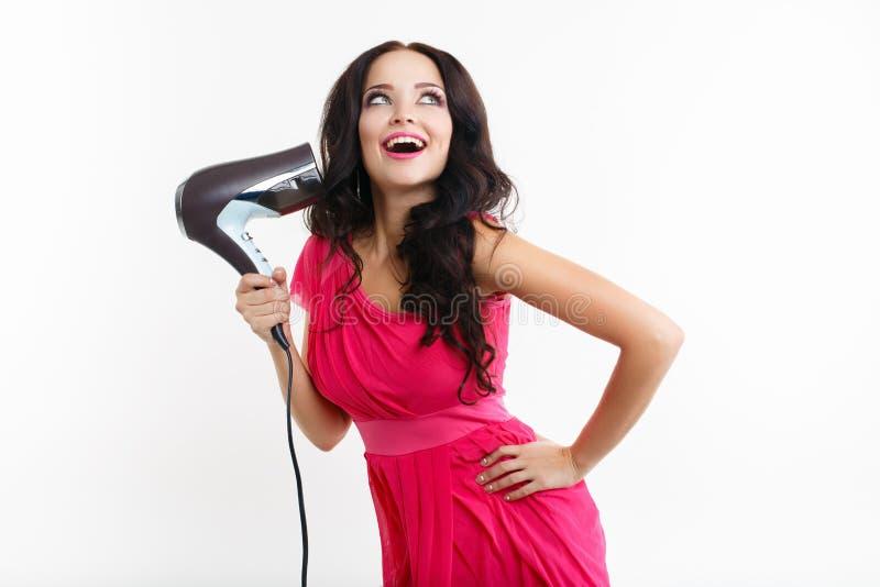 Jeune fille avec le hairdryer photo stock