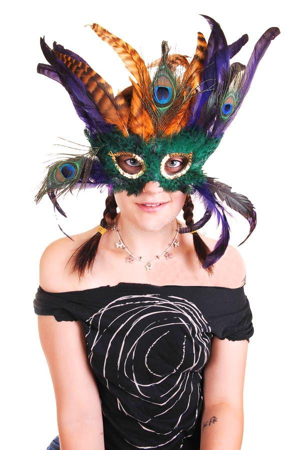 Jeune fille avec le masque de clavette. photo stock