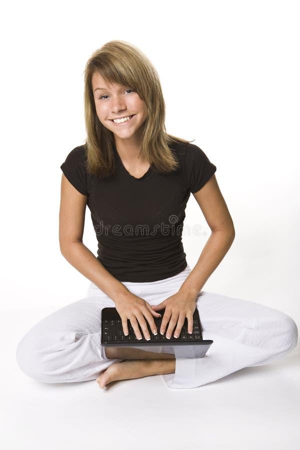 Jeune fille avec le netbook photos libres de droits