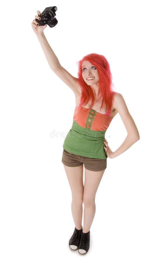 Jeune fille avec le photocamera d'isolement sur le blanc photo stock