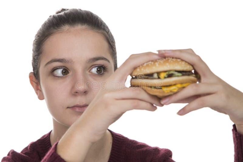 Jeune fille avec un hamburger photos stock