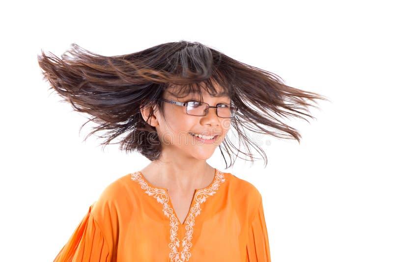 Jeune fille ayant l'amusement III de cheveux images stock