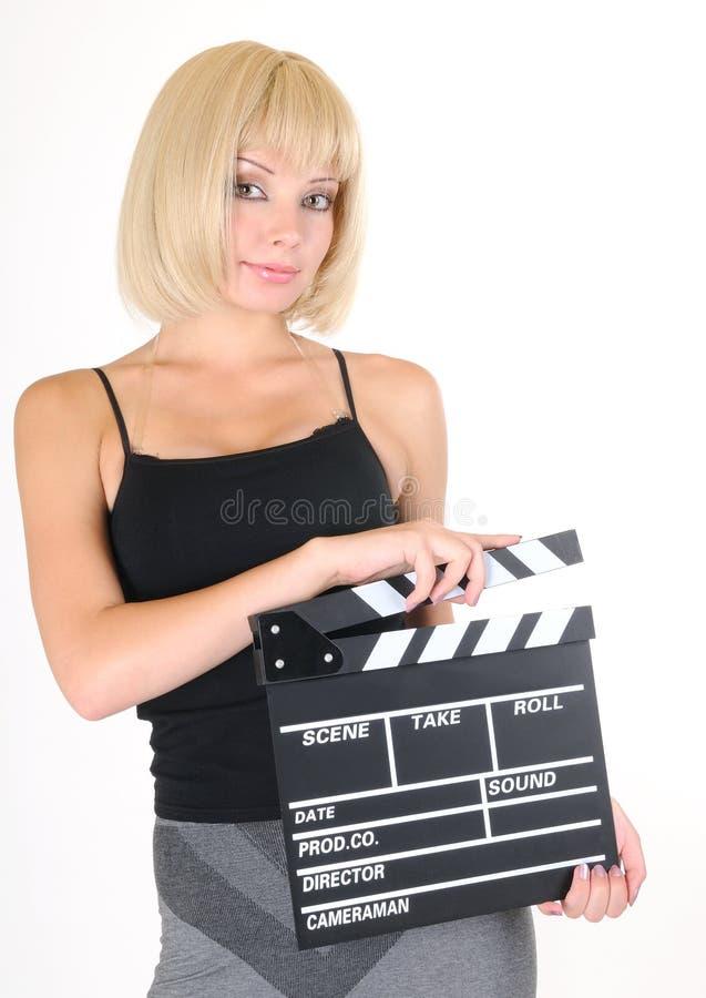 Jeune fille blonde avec le panneau de clapet images stock