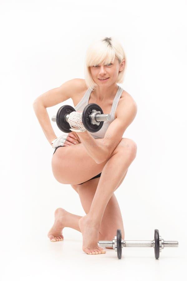 Jeune fille blonde dans la formation images stock