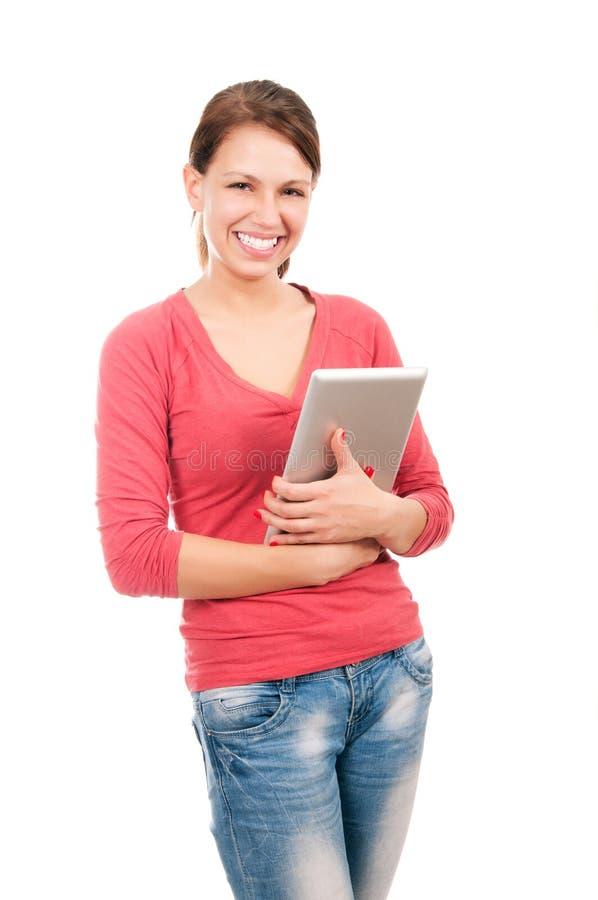 Jeune fille d'étudiant avec le PC de comprimé image stock