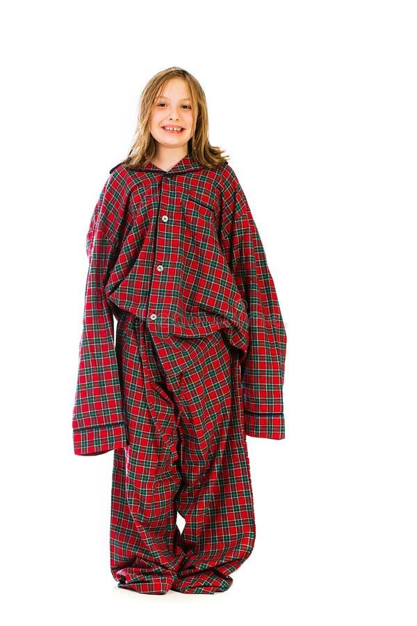 Jeune fille dans au-dessus des pyjamas classés photos stock