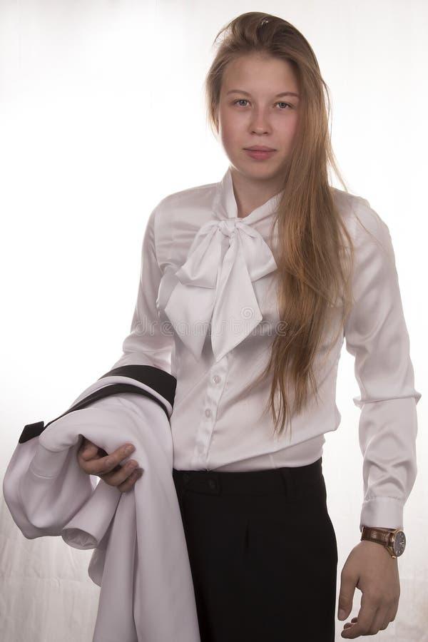 Jeune fille dans un costume photos stock
