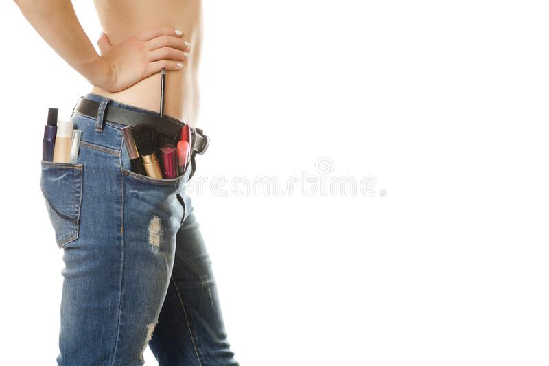 Jeune fille dans une poche de cosmétiques image libre de droits