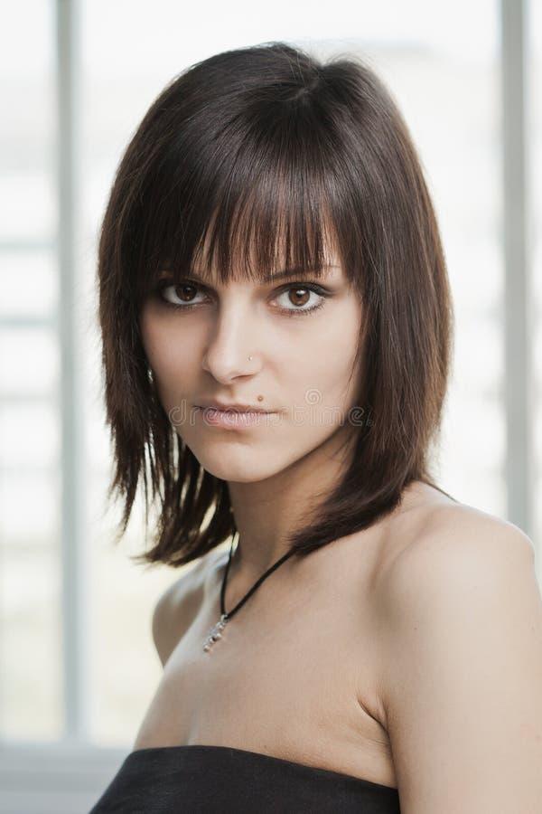 Jeune fille de brunette photo stock