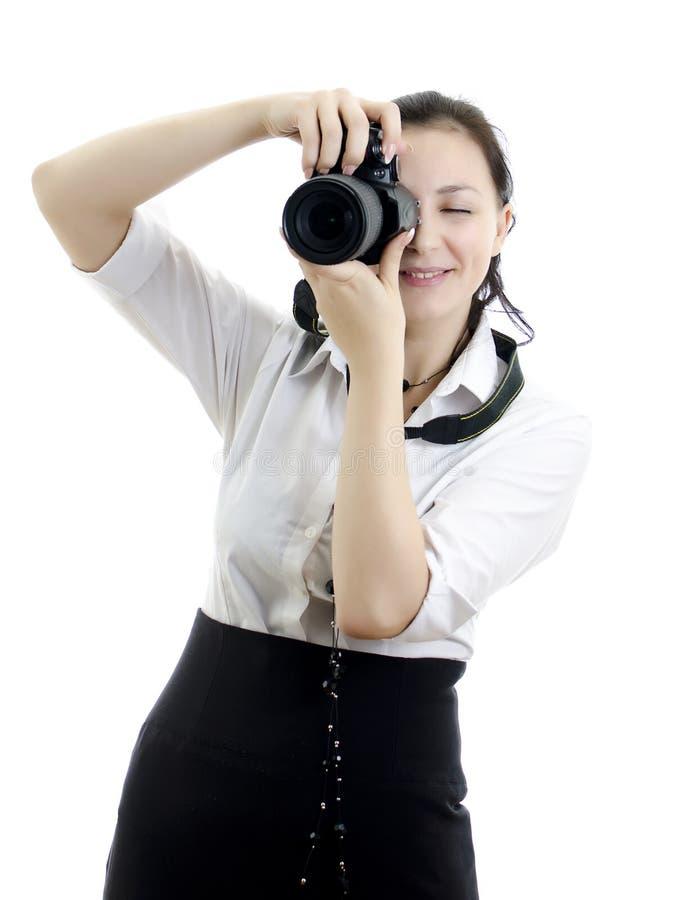 Jeune fille de brunette avec le photocamera photographie stock