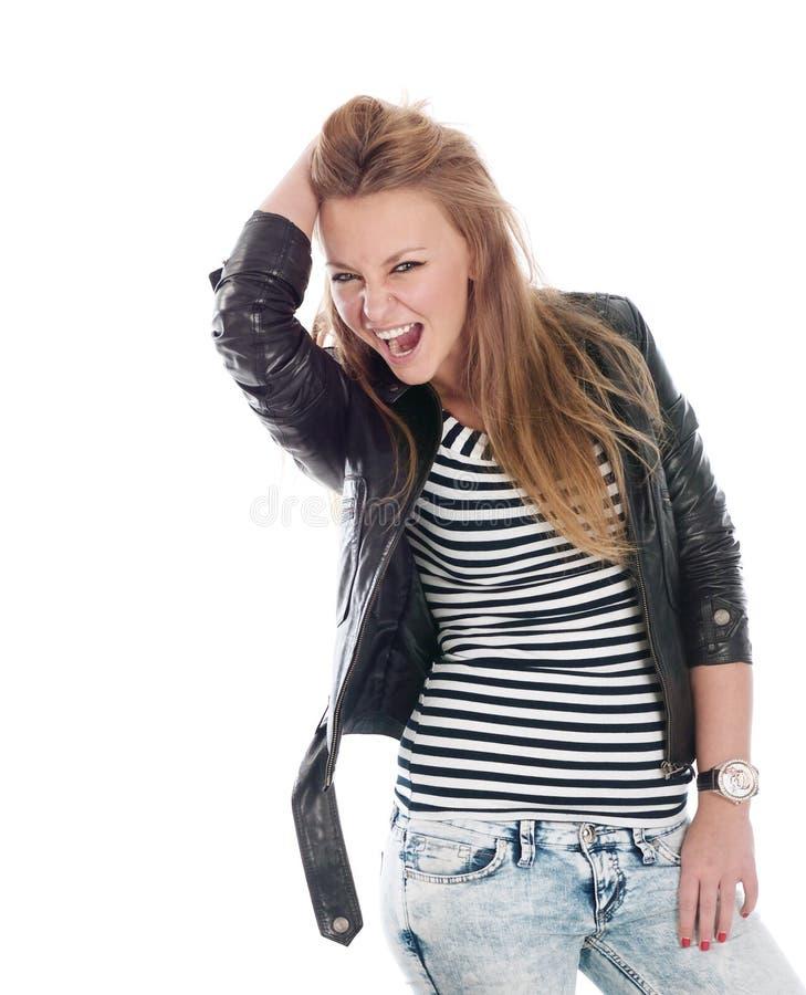 Jeune fille de l'adolescence posant sur le blanc. photographie stock libre de droits