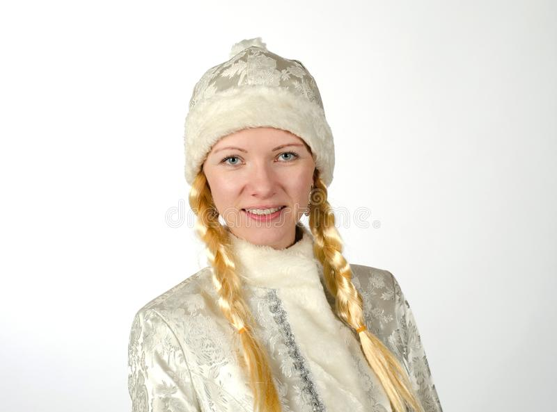 Jeune fille de neige avec le plan rapproché de tresses An neuf photographie stock libre de droits