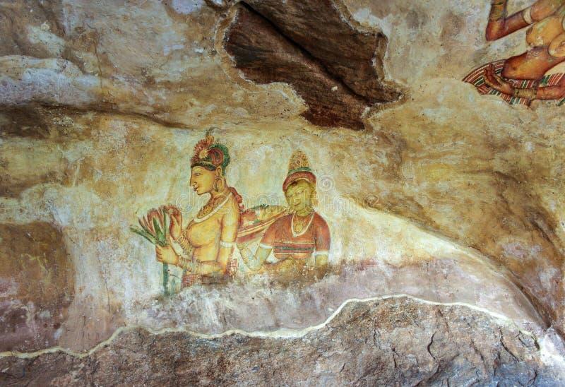 Jeune fille de Sigiriya - fresques du 5ème siècle au fortr antique de roche photographie stock