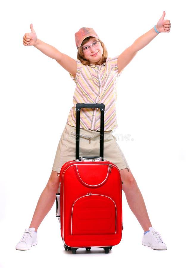 Jeune fille heureuse partant en vacances photo stock