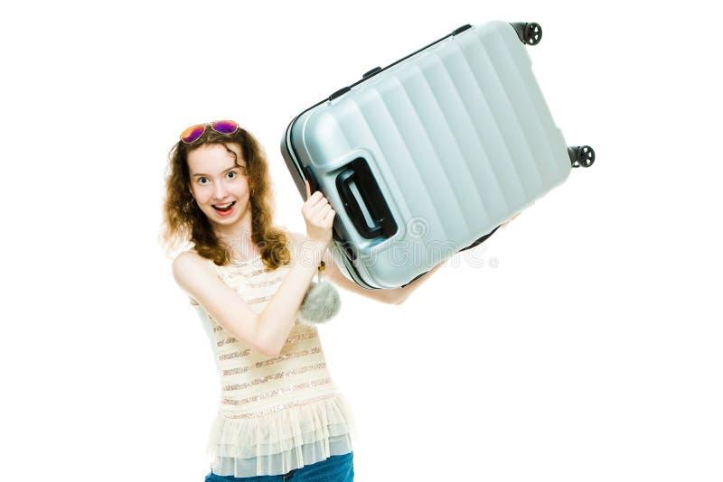 Jeune fille maigre tenant le bagage en plastique photo stock