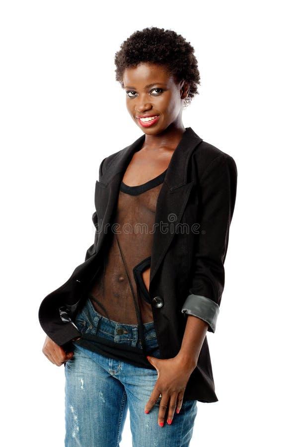 Jeune fille noire dans le blazer et des jeans images libres de droits