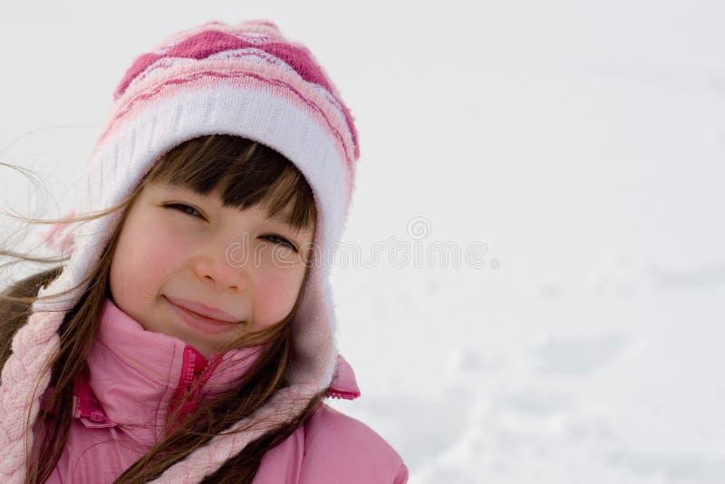 Jeune fille sur la neige photographie stock libre de droits