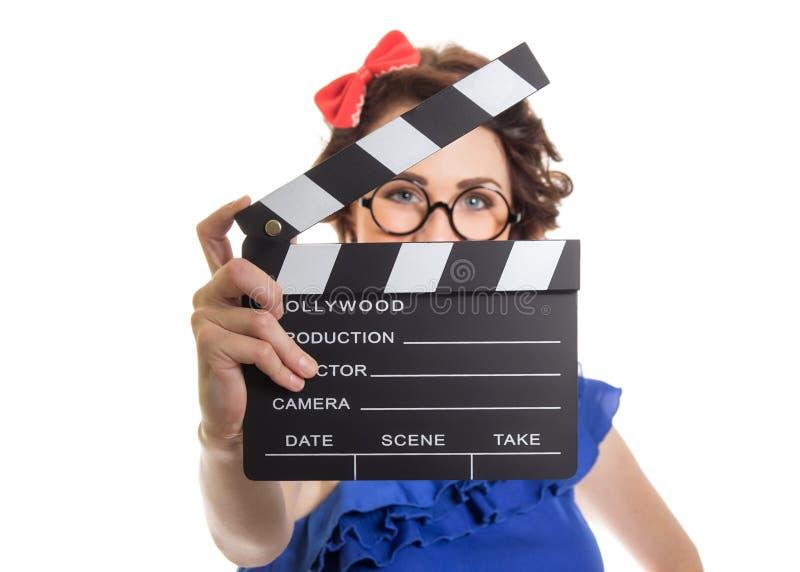 Jeune fille tenant le clapet de film image libre de droits