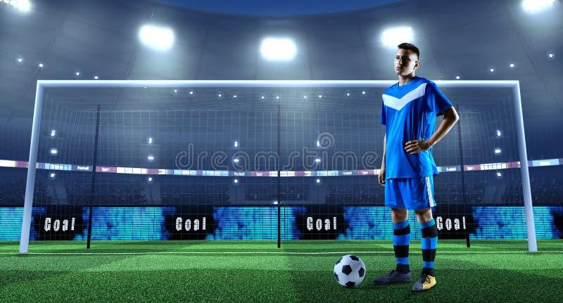 Jeune footballeur avec la boule devant le but sur un professi photos stock