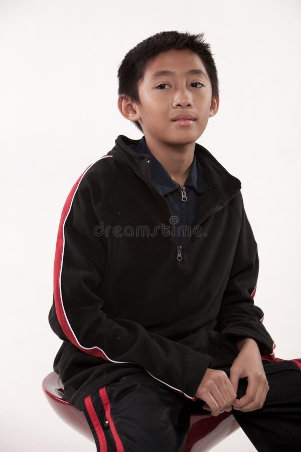 Jeune garçon asiatique de la préadolescence mignon image libre de droits