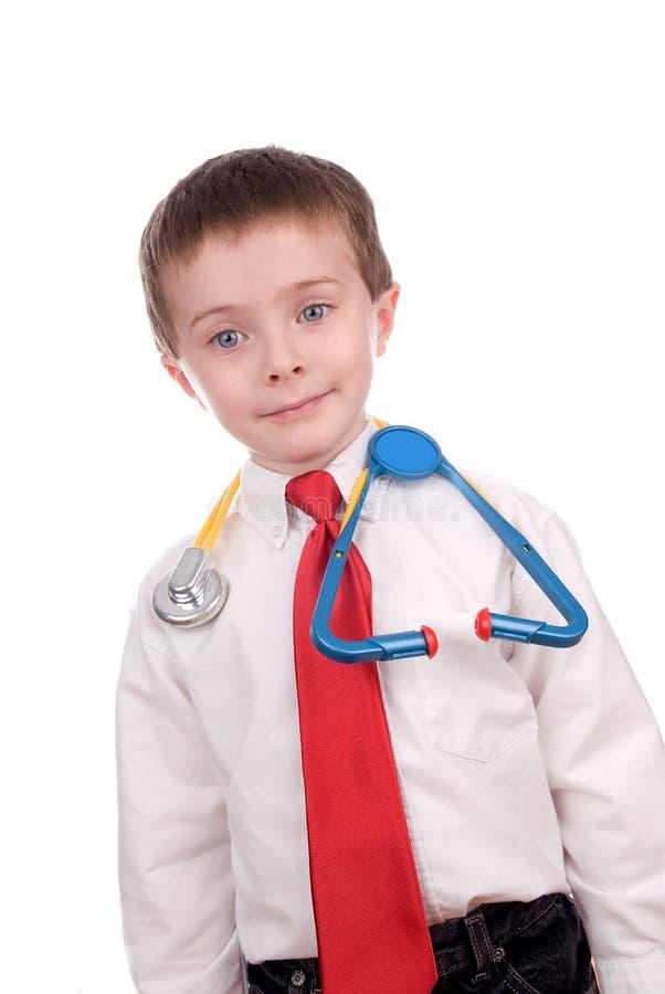 Jeune garçon attirant beau rectifié en tant que docteur images stock