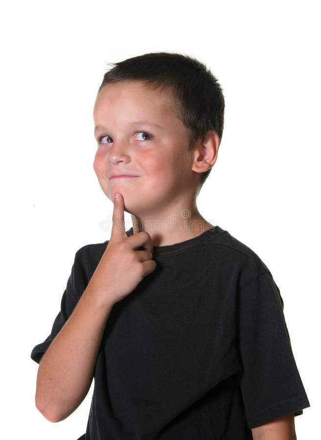 Jeune garçon avec des gestes expressifs photographie stock libre de droits