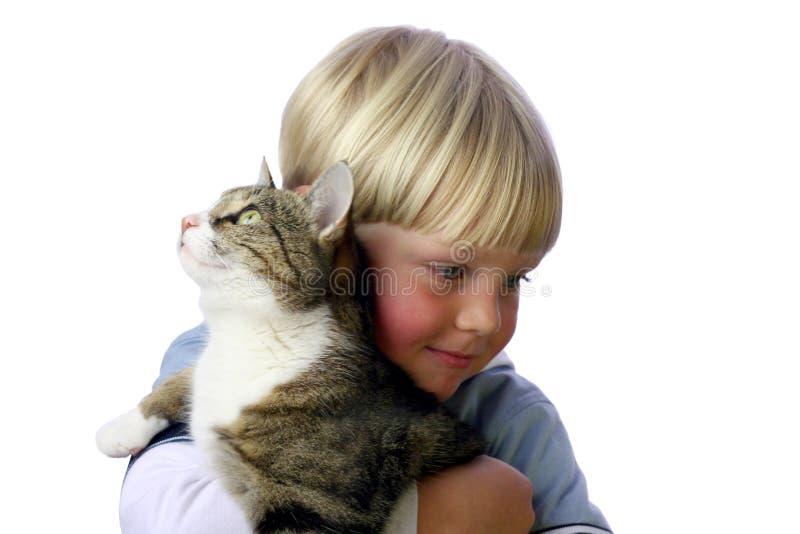 Jeune garçon avec le chat photo stock