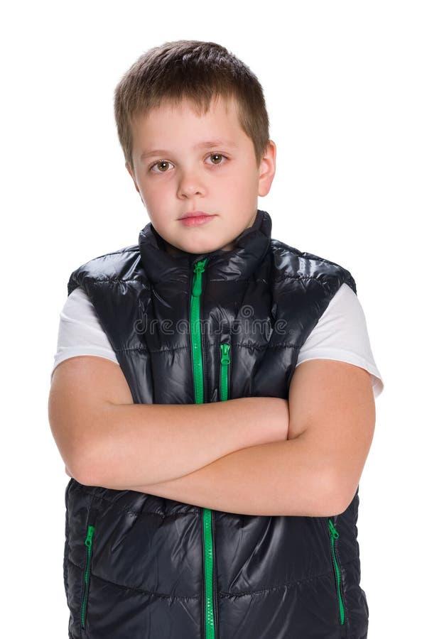 Jeune garçon songeur dans une veste photographie stock