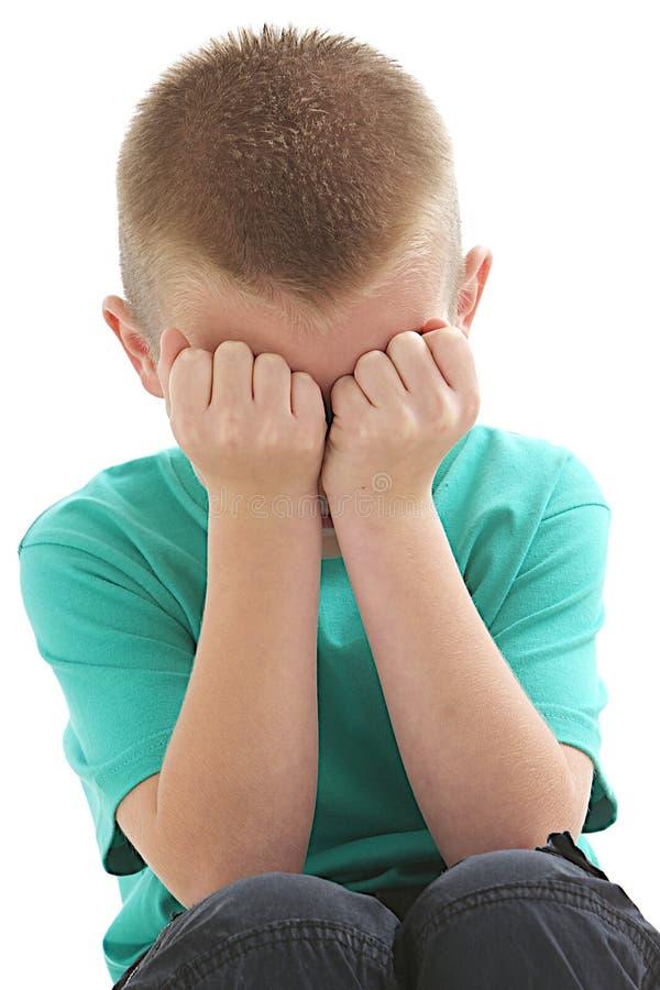 Jeune garçon triste photos libres de droits