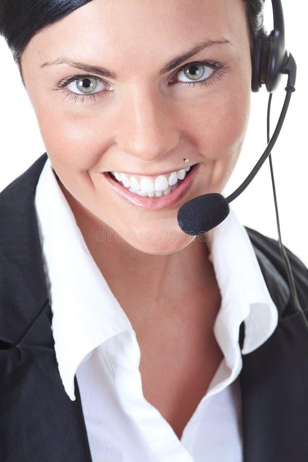 Jeune gentille femme d'opérateur d'appel sur un blanc photographie stock libre de droits