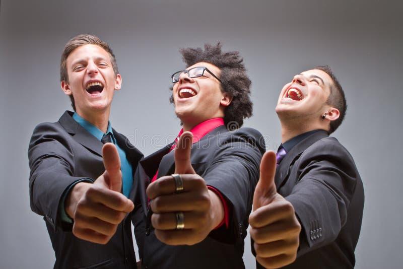 Jeune groupe de jeunes et dernier cri hommes d'affaires photos stock