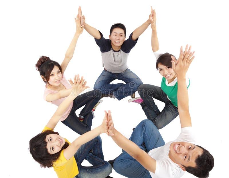 Jeune groupe heureux image libre de droits