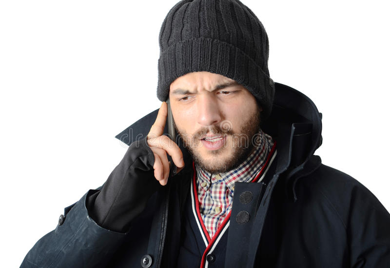 Jeune homme à l'aide d'un téléphone portable images stock