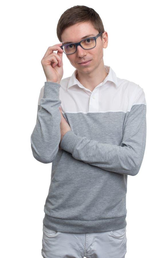 Jeune homme ajustant ses lunettes photos libres de droits