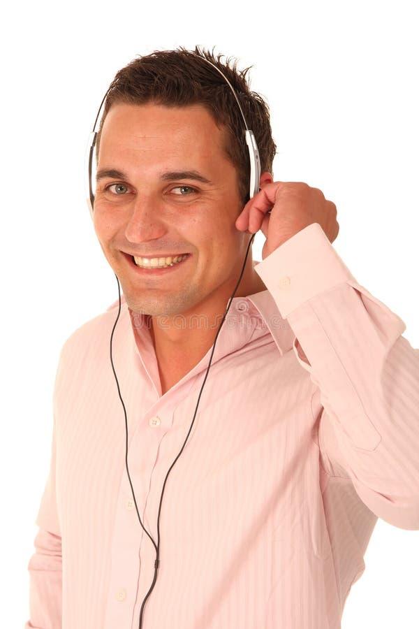 Jeune homme appréciant la musique images libres de droits