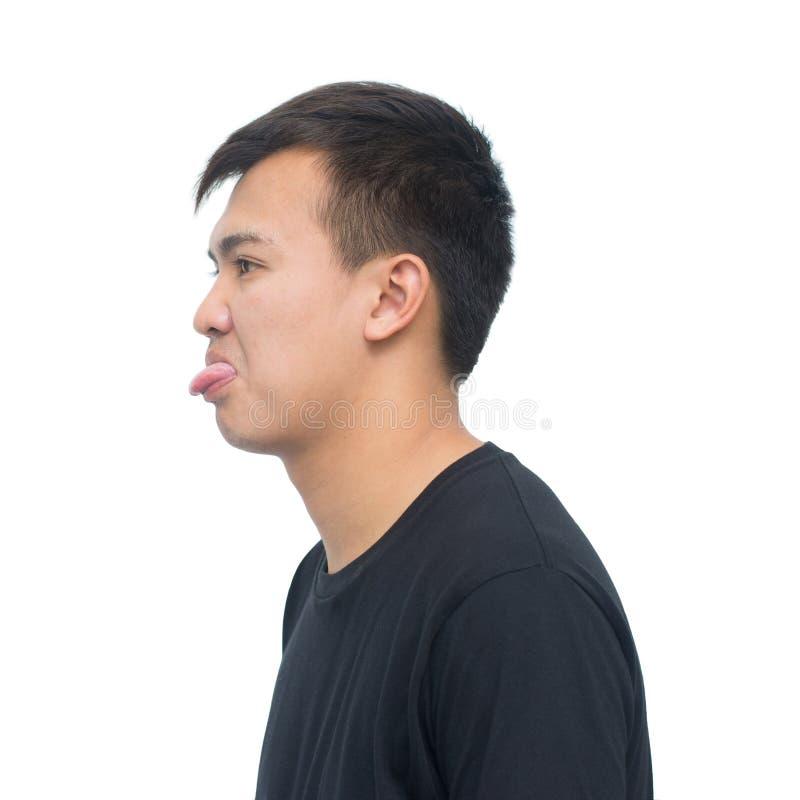 Jeune homme asiatique montrant la langue image libre de droits