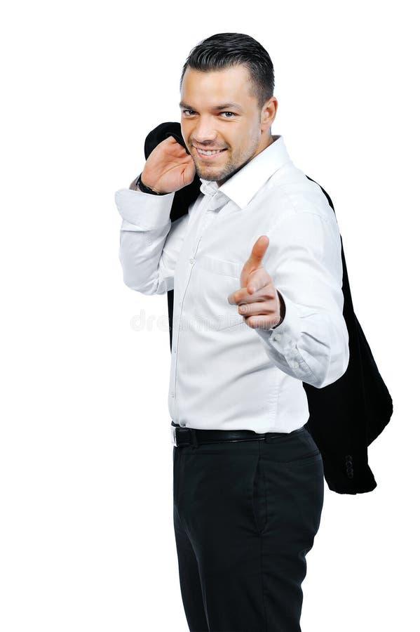 Jeune homme attirant d'affaires se dirigeant à vous et au sourire image libre de droits
