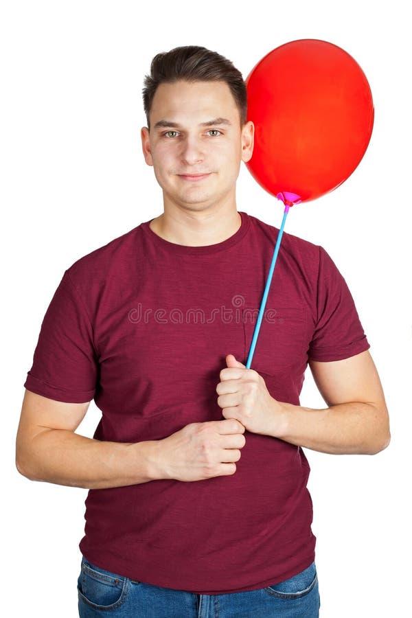Jeune homme avec le ballon rouge photo libre de droits