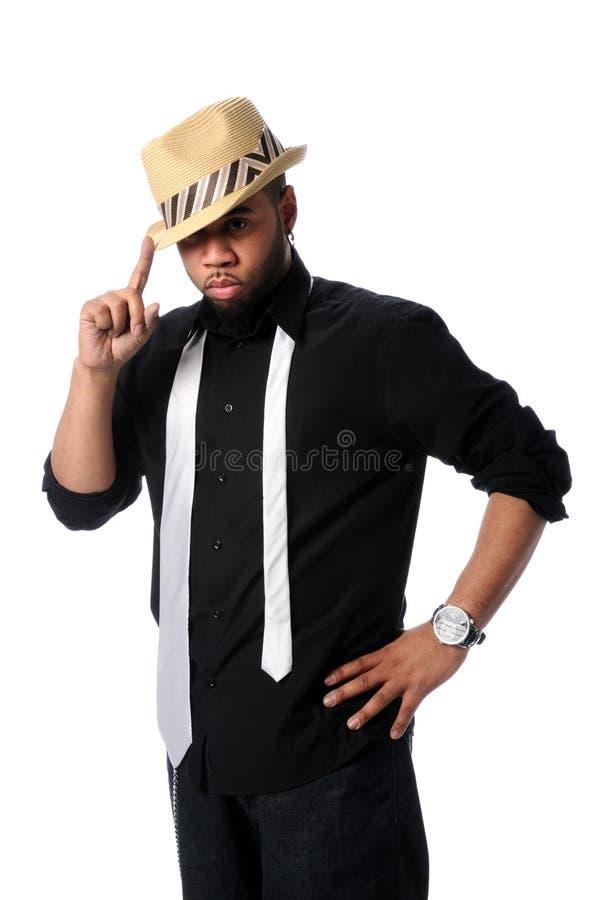 Jeune homme avec le chapeau de paille photo stock