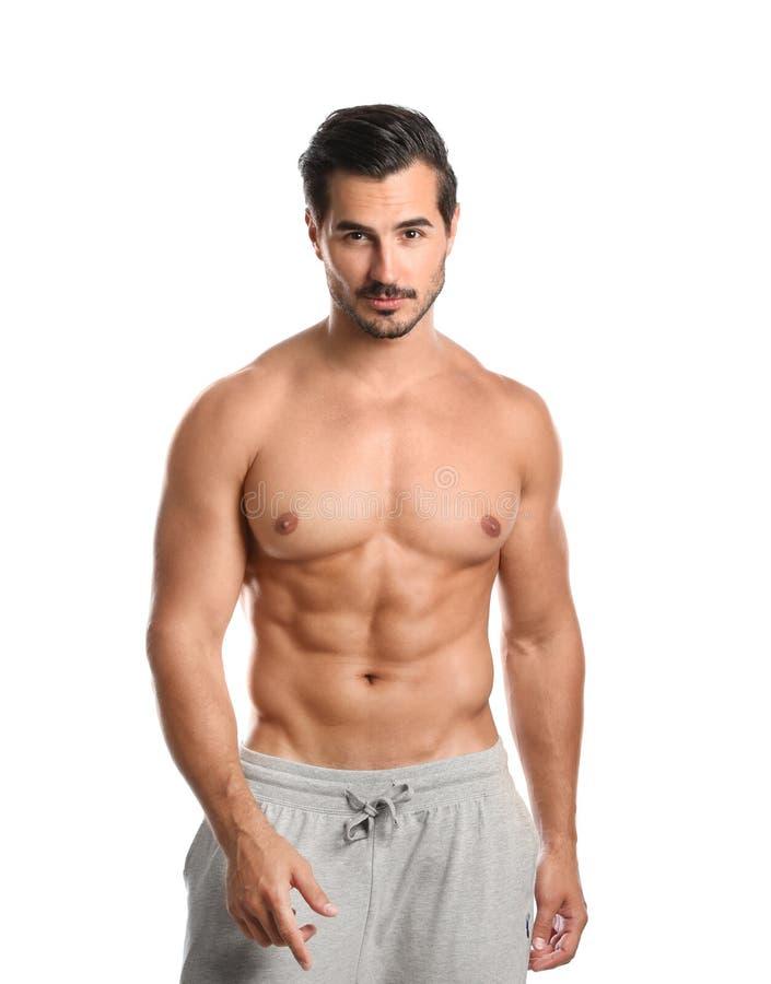 Jeune homme avec le corps mince sur le blanc images stock