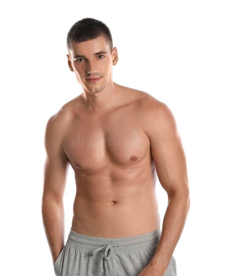 Jeune homme avec le corps mince sur le blanc image stock
