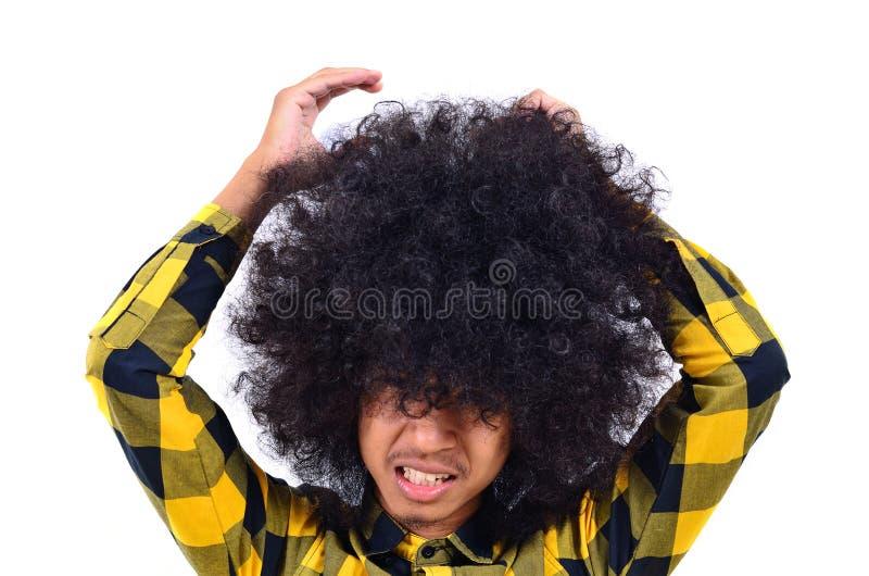 Jeune homme avec le long cheveu en tant que concept occupé images libres de droits