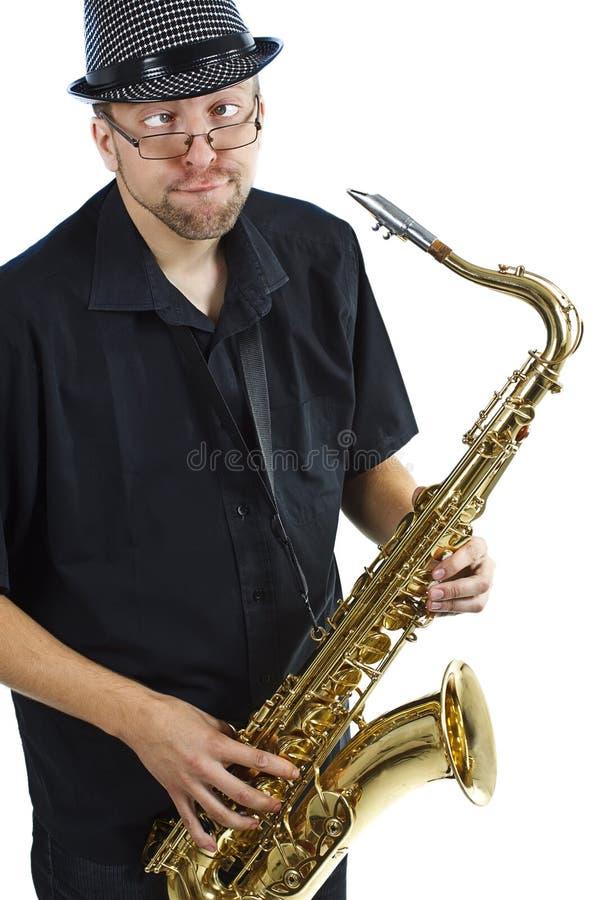 Jeune homme avec le saxophone images libres de droits