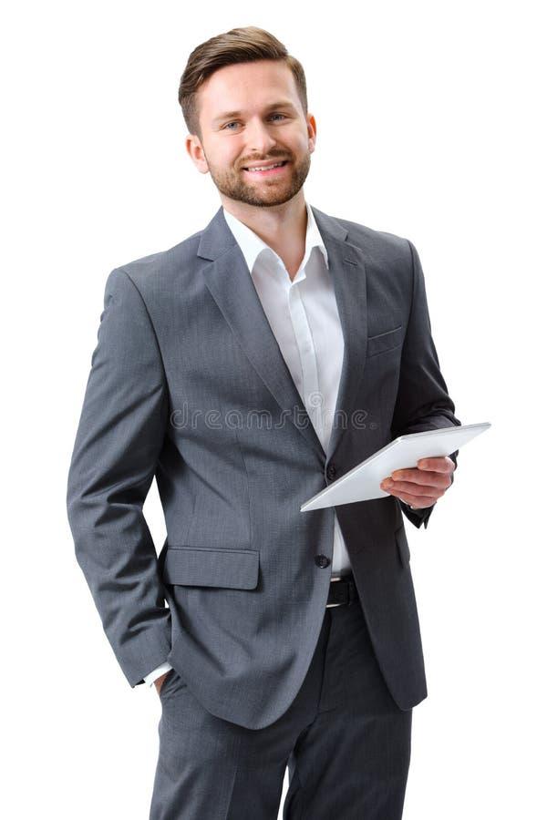 Jeune homme avec un comprimé numérique photographie stock