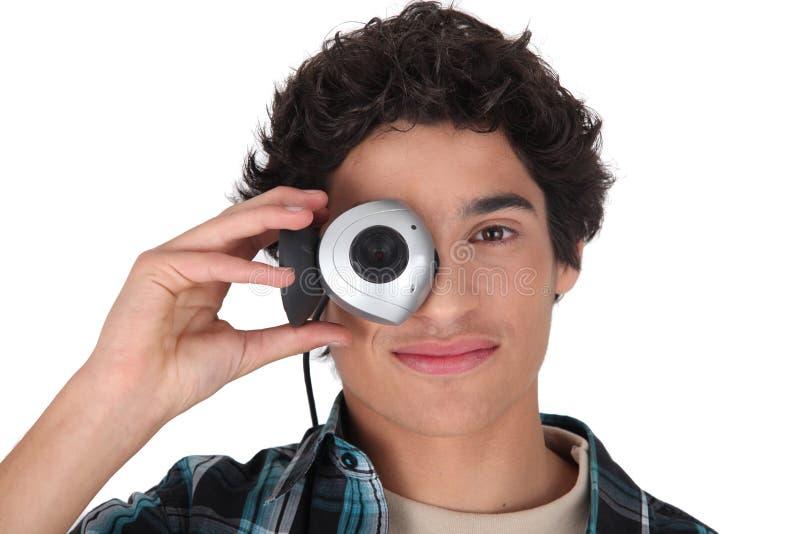 Jeune homme avec un webcam images libres de droits