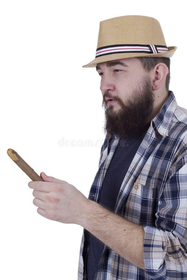 Jeune homme avec une barbe et un cigare photos stock