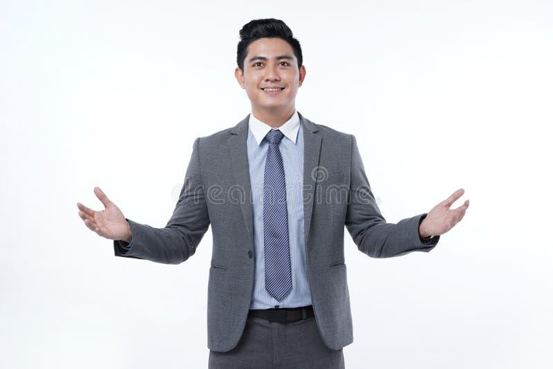 Jeune homme beau asiatique d'affaires d'isolement sur le fond blanc photos libres de droits