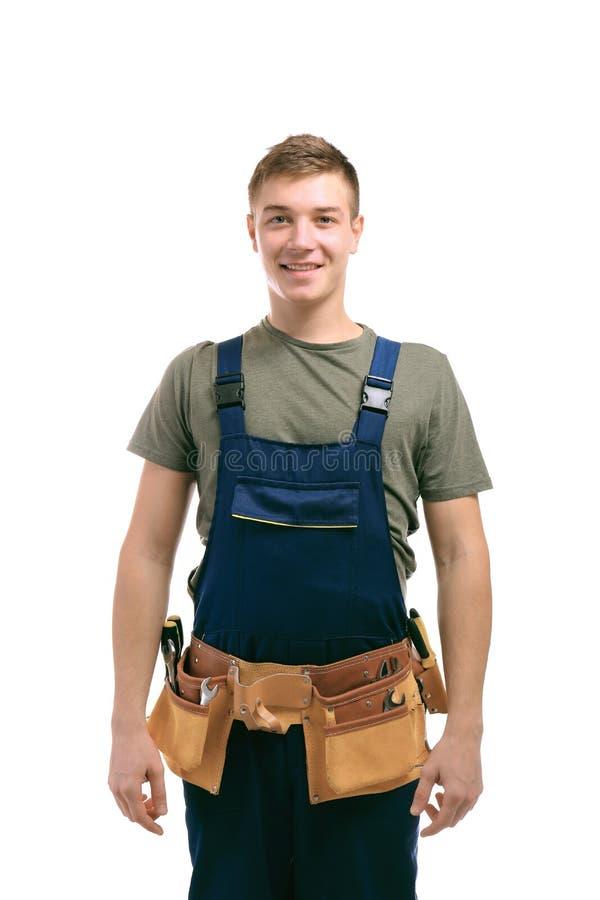 Jeune homme beau avec la ceinture d'outils sur le fond images libres de droits