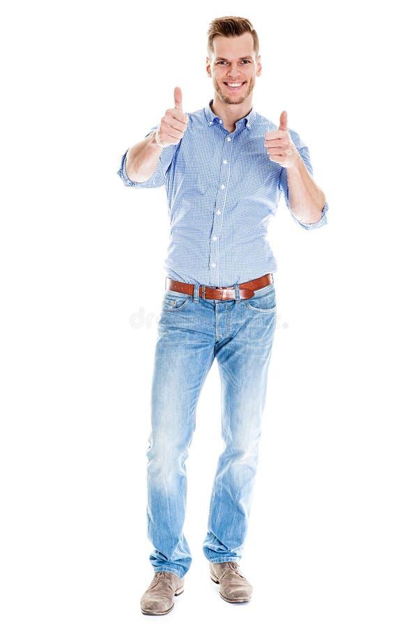 Jeune homme beau montrant le pouce  photos stock