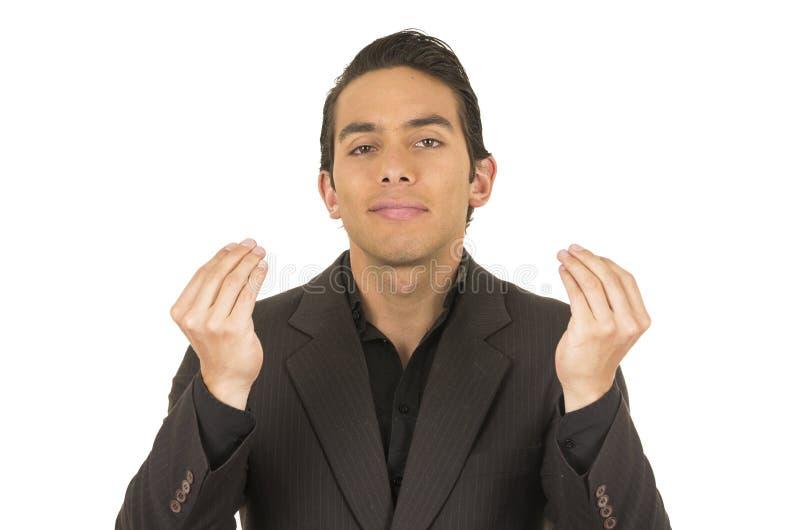 Jeune homme beau portant un costume posant avec photo libre de droits